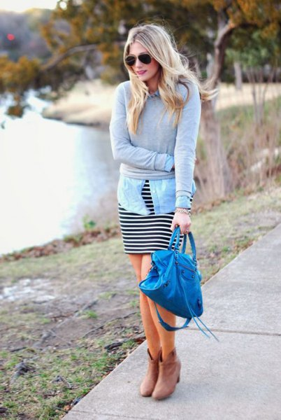 gray sweater with light blue chambray shirt and black and white striped dress