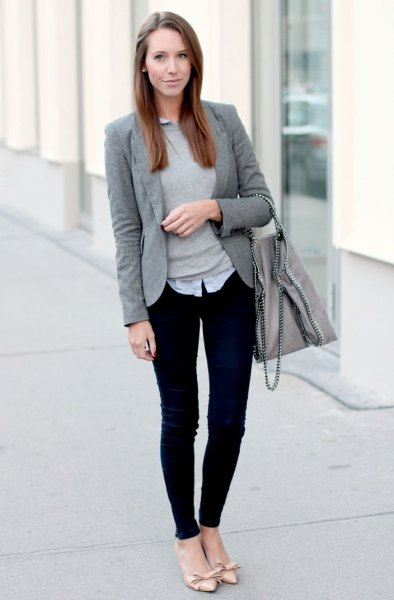 gray sweater with a light blue collar shirt and black, narrow chinos