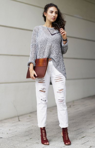 gray sweater with ripped white boyfriend jeans with cuffs