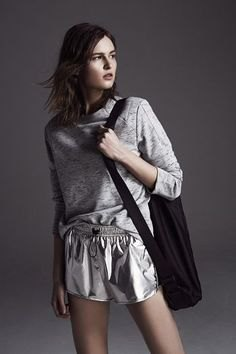 gray sweatshirt with silver, metallic flowing shorts