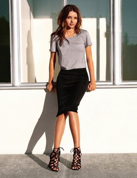 gray t-shirt with black midi skirt and strappy lace-up shoes