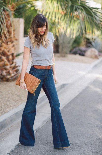 gray t-shirt with blue belt and high-waisted flare jeans