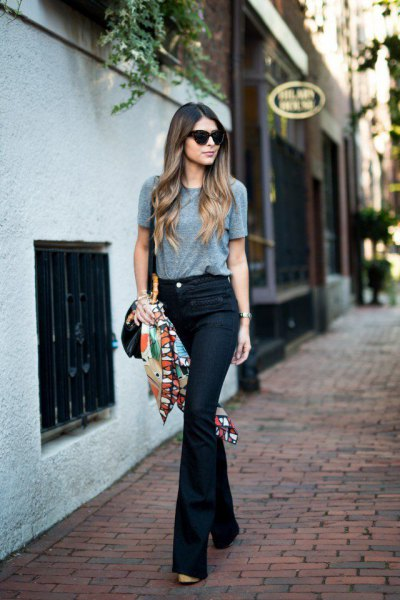 gray t-shirt with dark blue flared jeans