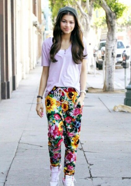 gray t-shirt with floral baggy pants and white high-top sneakers