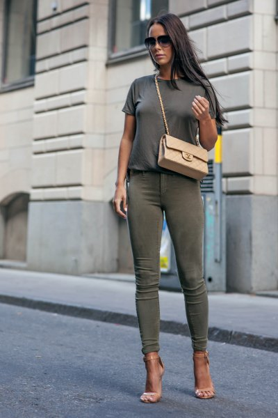 gray t-shirt with green skinny jeans and pink heels