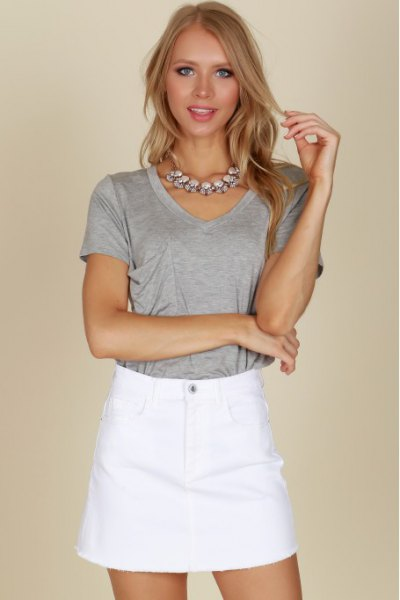 gray t-shirt with high waisted mini skirt