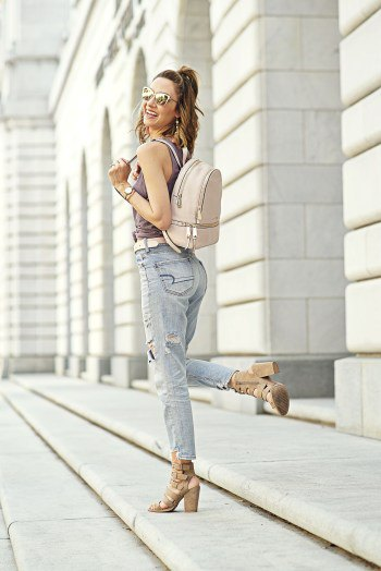 gray tank top with boyfriend jeans and light pink leather backpack wallet