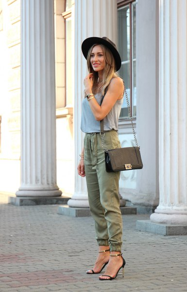 gray tank top with green khaki joggers and black felt hat