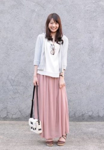 gray three-quarter-sleeved hooded jacket with hood and blushing pink maxi skirt