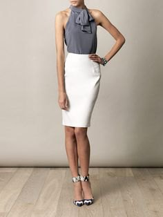 gray halterneck top with tie neck and high-waisted white skirt