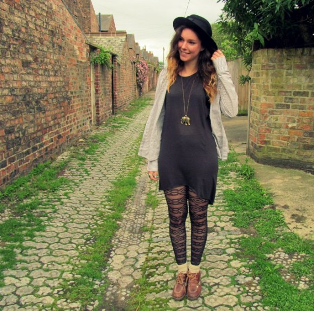 gray tunic dress with white cardigan and patterned tights