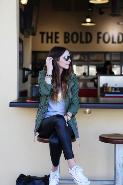 gray tunic t-shirt and black leather gaiters