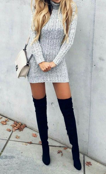 gray turtleneck with long sleeves and figure-hugging mini sweater dress with thigh-high black boots with high heels