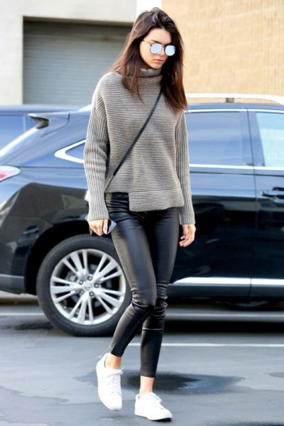 gray turtleneck with relaxed fit and black leather gaiters