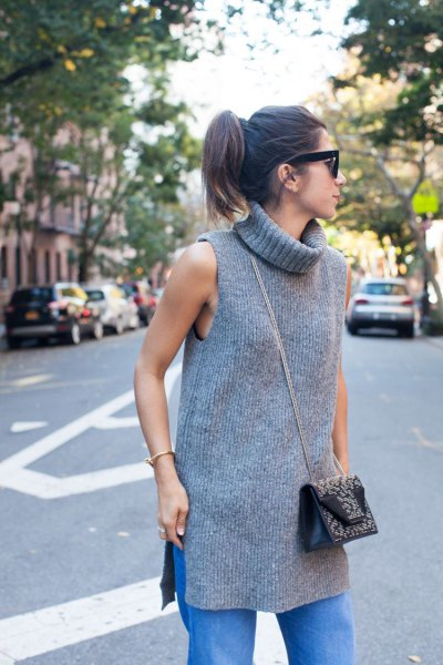 gray sleeveless rib tunic with turtleneck and blue straight leg jeans