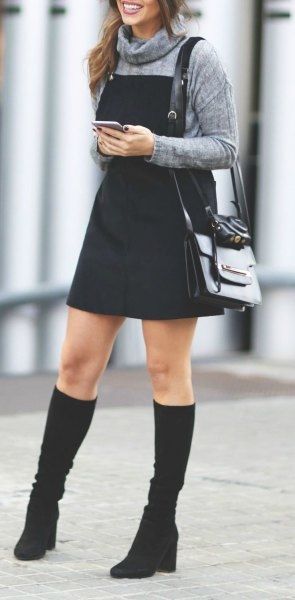 gray turtleneck black pinafore dress