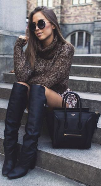 gray turtleneck with a printed mini skirt and square toe boots above the knee