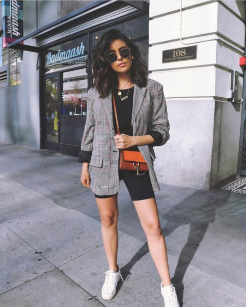 gray tweed blazer with black cycling shorts and white sneakers