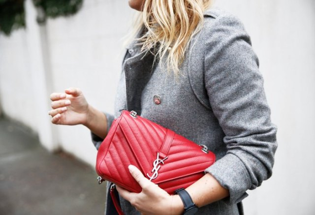 gray tweed blazer with red quilted leather handbag and jeans