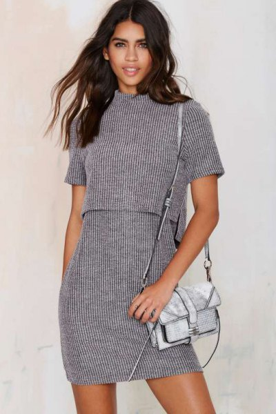 gray two-piece, short-sleeved, ribbed dress with a stand-up collar