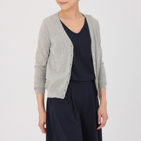 gray V-neck cardigan, black sweater and wide-leg pants