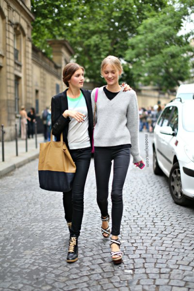 gray V-neck sweater with black crew-neck t-shirt and dark jeans