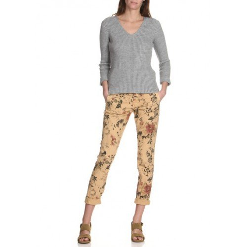 gray V-neck sweater and slim-fitting chinos with a pink floral pattern