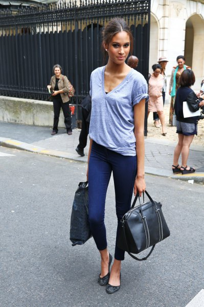 gray V-neck T-shirt and dark blue, narrow ankle pants
