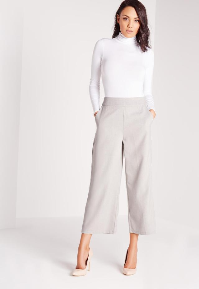gray wide pants and white sweater