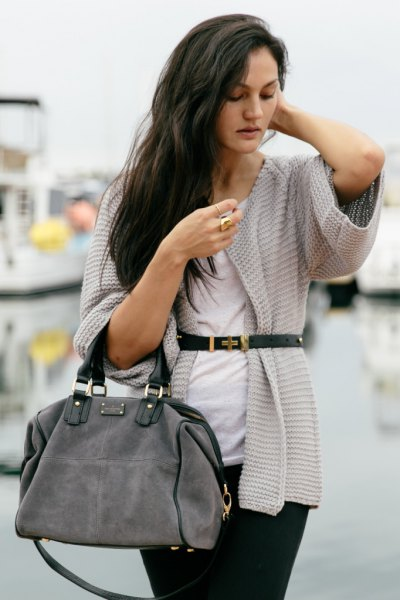 gray cardigan with wide sleeves and black slim fit jeans