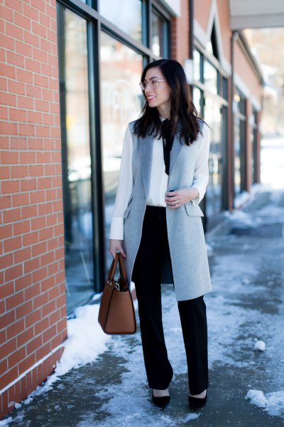 gray wool longline vest with white blouse and black chinos with straight legs