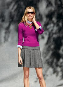 Mini pleated skater skirt made of gray wool with a matching, figure-hugging sweater