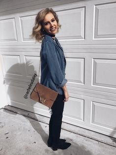 gray-blue shirt with buttons, black slim fit jeans and gray suede shoulder bag