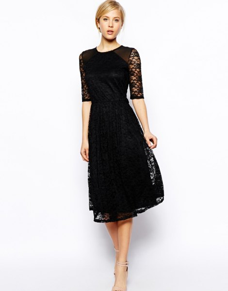 black dress with half sleeves and a flared lace dress