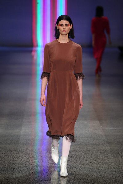 half-sleeved midi dress with brown fringes and white boots