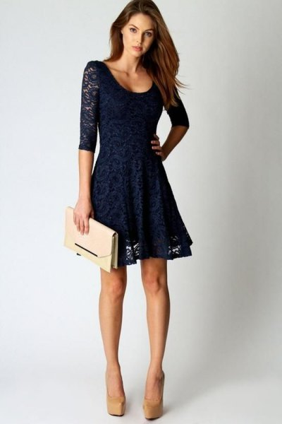 half sleeve with scoop neckline and flared, midnight blue lace mini dress