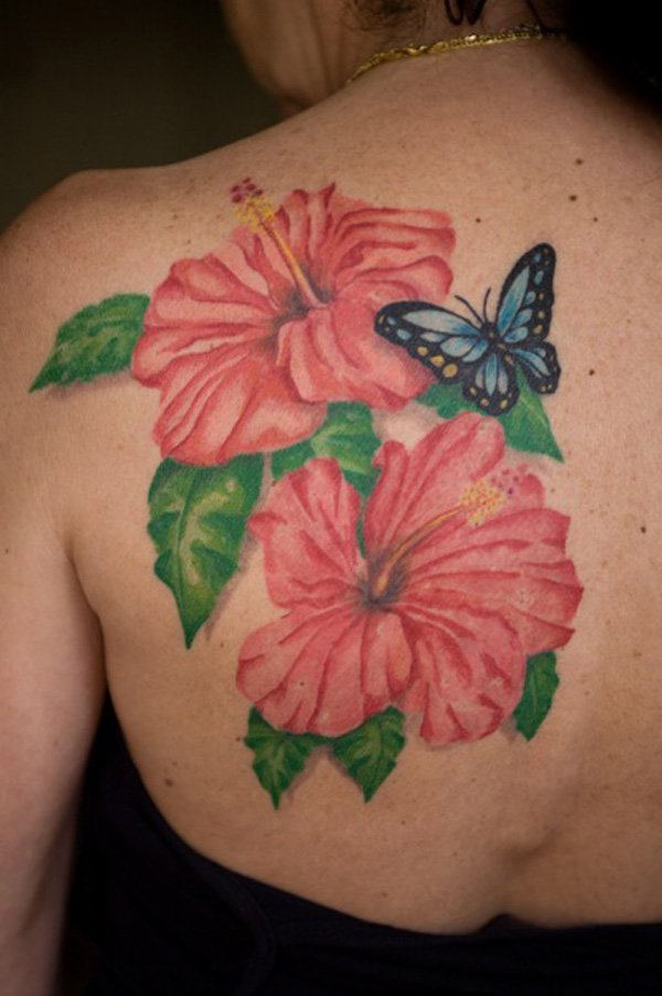 Hawaii flower with butterfly tattoo on the upper back