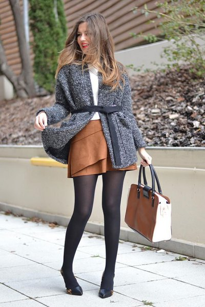 gray cardigan with gray belt and brown suede mini-rater skirt