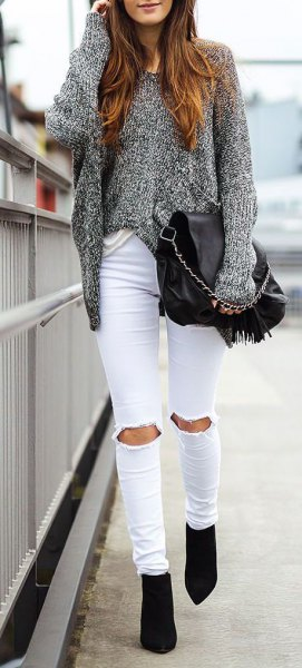heather gray, chunky sweater with ripped white jeans
