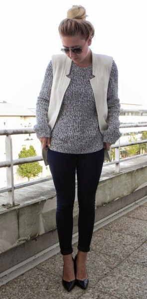 heather gray knitted sweater with round neckline, white vest