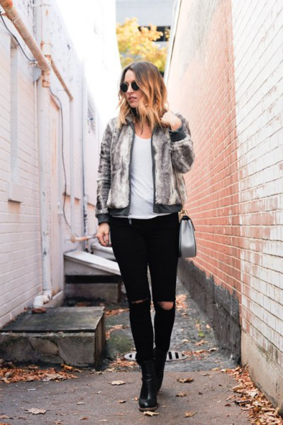 heather gray fur bomber jacket with black, torn slim fit jeans