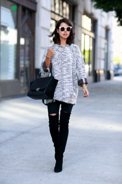 heather gray knitted sweater with black, ripped knee jeans