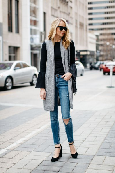 gray gray long vest with black bell-sleeved blouse