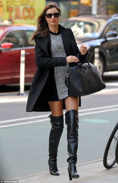 heather gray mini sheath dress with a long black wool coat and high leather boots