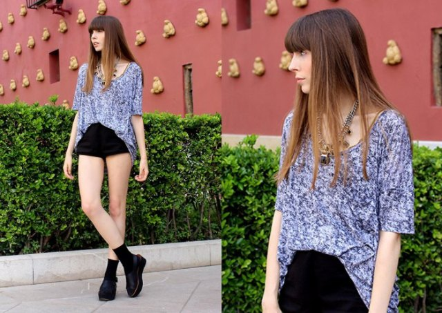 heather gray oversized t-shirt with scoop neckline and black high-rise shorts