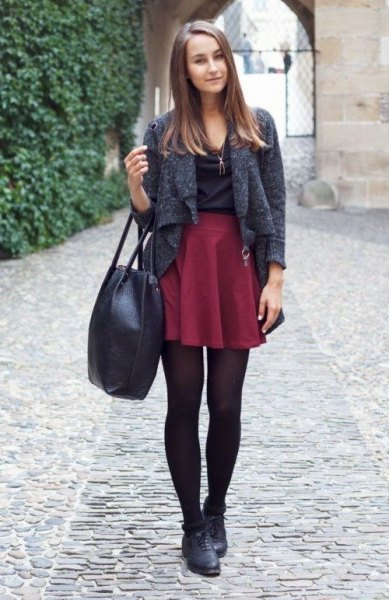 heather gray short wool jacket with a maroon mini pleated skirt