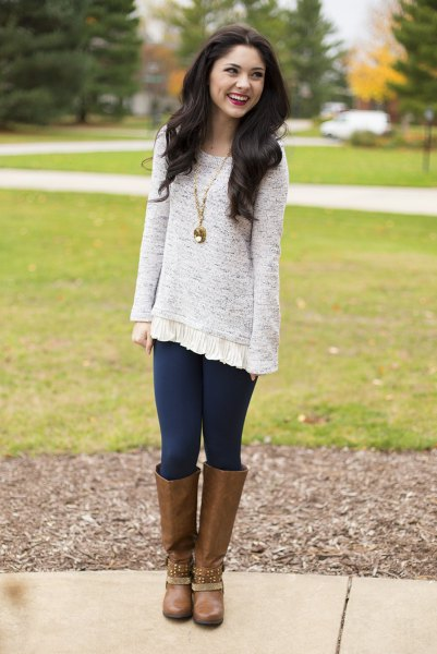 heather gray tunic sweater with dark blue leggings and brown knee-high boots