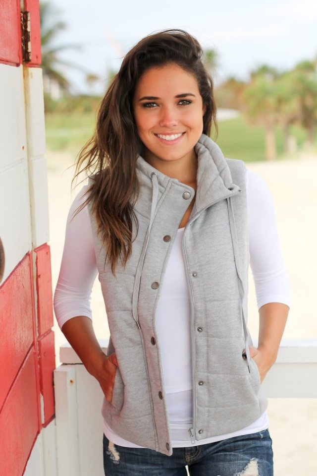 gray mottled quilted vest over white T-shirt