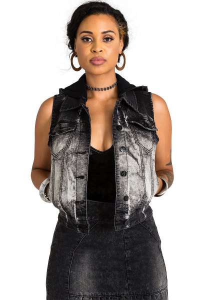 heavily washed denim vest with black mini dress with deep V-neck