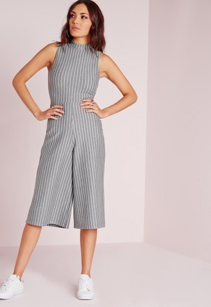 gray and white striped jumpsuit with a high neck